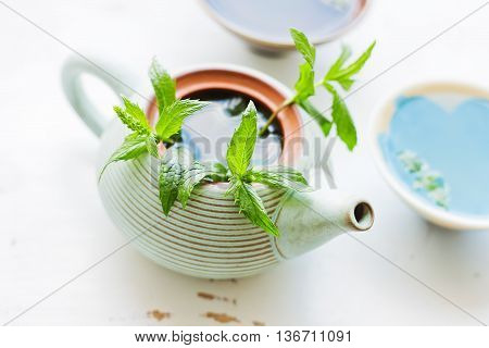 Tea ceremony - lemon ginger tea with mint - teapot with two bowls - pure and fresh look