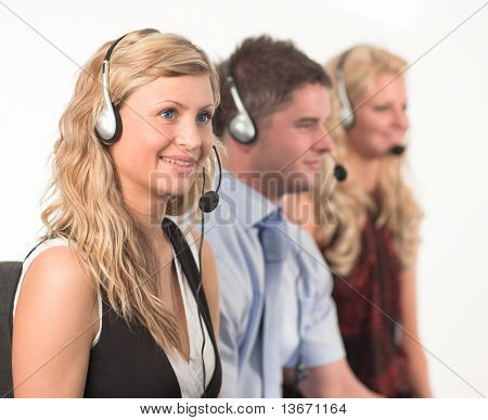 Three working in in a call centre