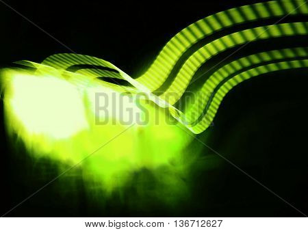 Waves of green and yellow light on black background. Design background or abstract background with copy space.