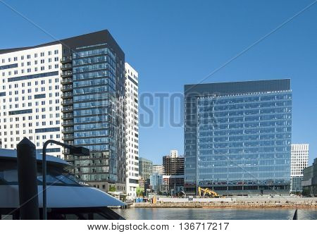 Boston Massachusetts USA - June 30 2016: Multiple construction projects filling in among existing buildings in South Boston's Seaport District
