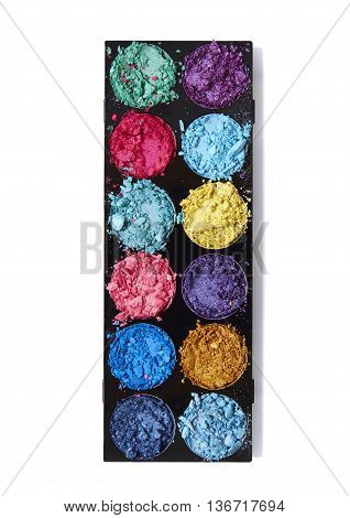 Smashed eyeshadow make up palette in bright colours, isolated on a white background
