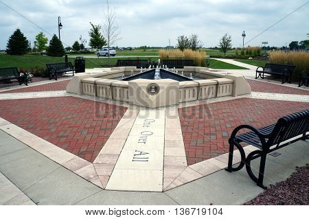 SHOREWOOD, ILLINOIS / UNITED STATES - AUGUST 30, 2015: The Village of Shorewood Towne Center Veterans' Memorial honors those who served in the armed forces of the United States.