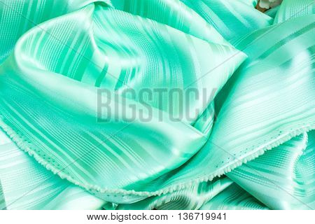 The smooth green silk green clothing background