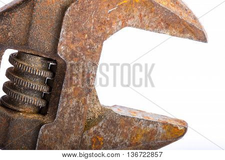 Close up of an old rusty adjustable wrench on a white background