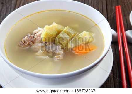 pork lib bitter gourd soup on the wooden background