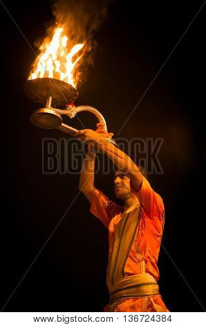 VARANASI INDIA-02 OCT:A Hindu priest performs the Ganga Aarti ritual on 02 Oct 2014 in Varanasi.Fire puja is a Hindu ritual that takes place at Dashashwamedh Ghat on the banks of the river Ganges