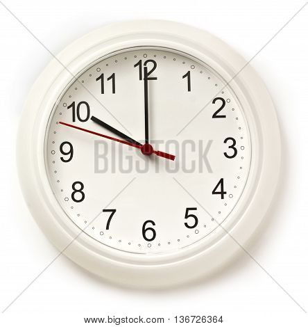 A photo of a typical office white clock with hands pointing at 10 o'clock isolated on white; the beginning of the workday concept