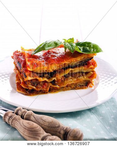 Eggplant and zucchini lasagna slice on plate