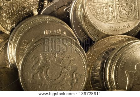 A lot of shiny coins of one british pound