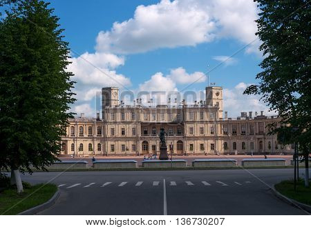 Gatchina Palace. Palace Square and the main entrance. Central building with balconies, lateral tower, lights and water moat. View from the Baltic Railway Station.