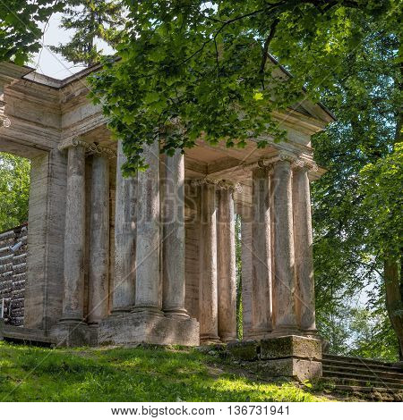Russia. Gatchina Palace Park. Birch House. In front is a portal mask. Built in the 18th century