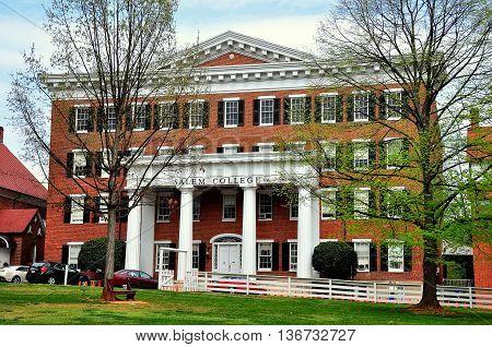 Old Salem North Carolina - April 21 2016: Salem College faces the Salem Square Village Green *