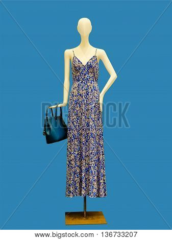 Beautiful summer dress on female mannequin isolated on white background. No brand names or copyright objects.