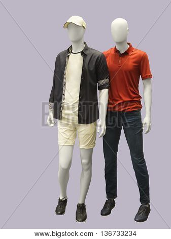 Two male mannequins dressed in casual clothes isolated. No brand names or copyright objects.