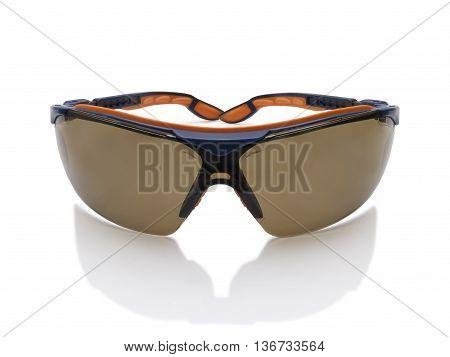Dark toned safety glasses goggle isolated on white background