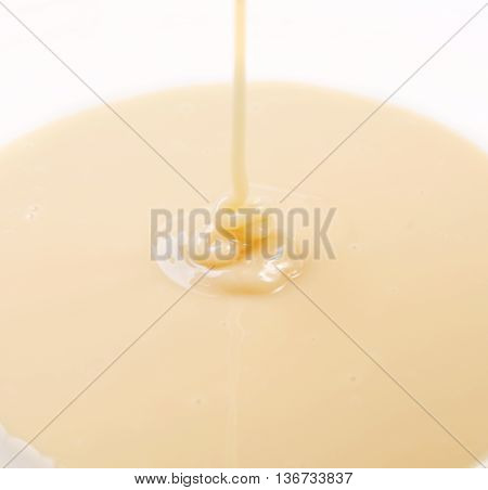 Sweetened condensed milk isolated on white background.