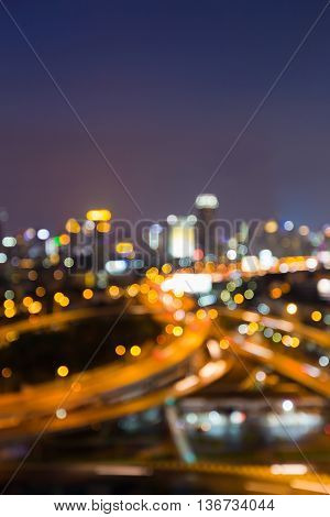 Nights blurred bokeh interchanged road and city downtown background