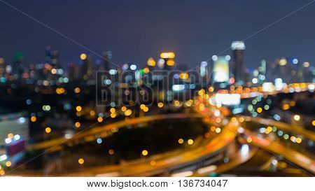 Twilight  blurred bokeh interchanged road and city downtown background