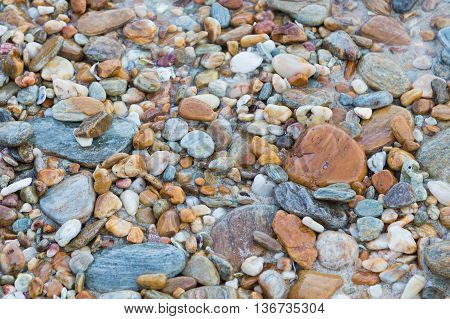 Round sea stone, natural background and teture