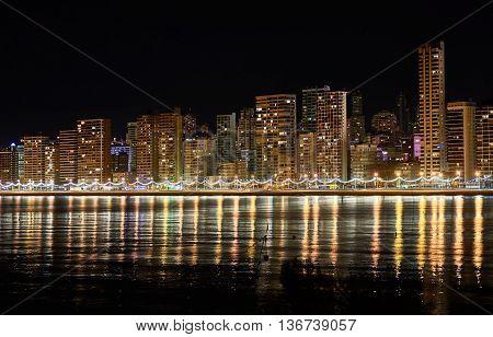 Benidorm skyline. Illuminated skyscrapers of a Benidorm city at night. Costa Blanca Alicante province. Spain
