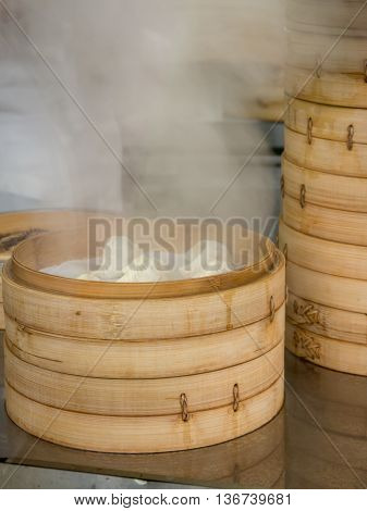 Jiaozi also known as gyoza steamed in bamboo dim sum baskets.