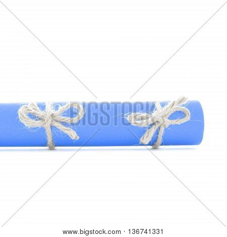 Natural handmade cord bows tied on blue paper roll isolated