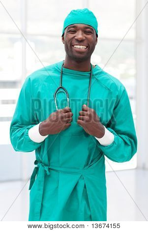 young confident doctor looking at camera and smiling