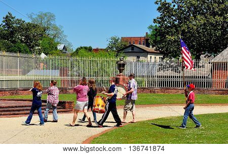 New Bern North Carolina - April 24 2016: Volunteer Fife and Drum Corps marching across the inner courtyard at 1770 Tryon Palace  *