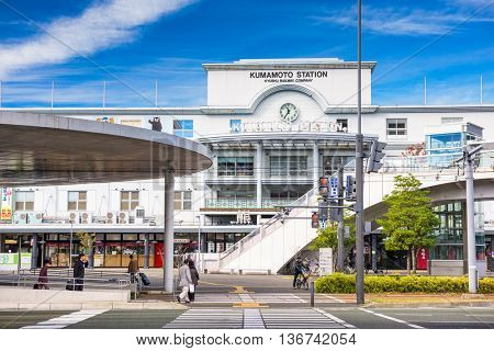 KUMAMOTO, JAPAN - DECEMBER 9, 2016: A street car pulls out of Kumamoto Station. It is the main railway terminal of the city.