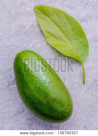 Fresh Avocado On Stone Background. Organic Avocado Healthy Food Concept..the Avocado Is Popular In V