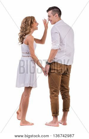 Surprised young couple. Portrait of amazed couple against isolated white background in full length with copyspace