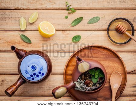 Herbal Tea Pot With Fresh Herbs Sage ,peppermint , Dried Chrysanthemum And Lime Slice On Rustic Wood
