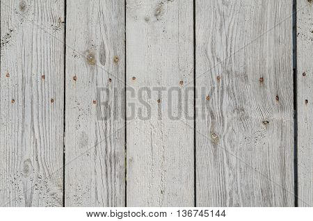 Texture of unpainted wooden boards with visible wooden texture and knots
