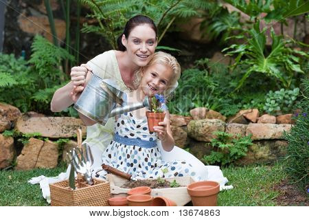 Young Mother and child Gardening
