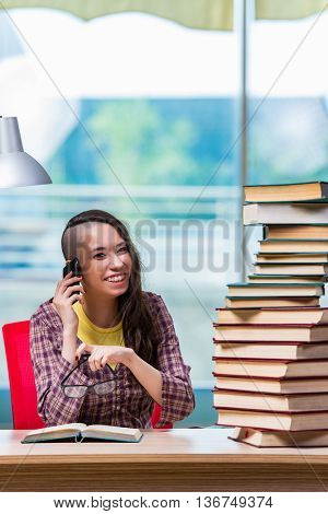 Young female student talking on mobile phone