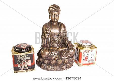 Figure of sitting Buddha with two tea boxes