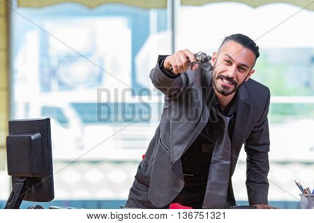 Angry aggressive businessman with gun in the office
