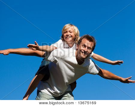 Young Child on his father's back