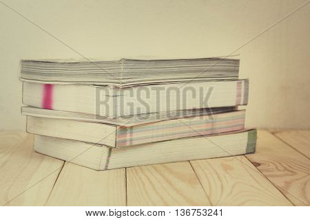 Book Stacked on wooden table Vintage retro picture style