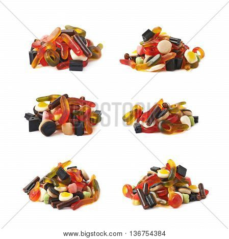 Pile of multiple colorful gelatin and licorice based candies isolated over the white background, set of six different foreshortenings