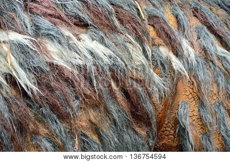 Grey, brown, and white soft feathery texture