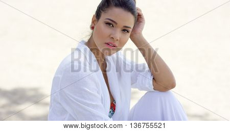 Charming woman sitting with head resting on hand