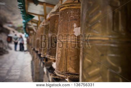 A circuit of prayer wheels at Tashi Lhunpo monastery, Shigatse, Tibet.