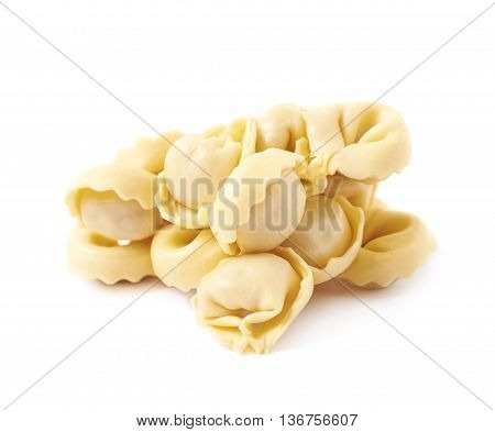 Pile of multiple stuffed ravioli sumplings isolated over the white background
