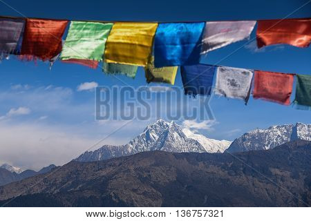 mountain view of Annapurna range (part of Himalaya) and Buddhist prayer flags, Nepal