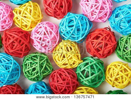 Surface covered with the multiple decorative and colored straw balls as an abstract background composition
