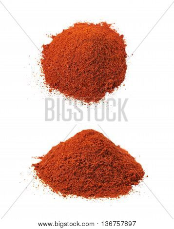 Pile of red paprika powder isolated over the white background, set of two different foreshortenings