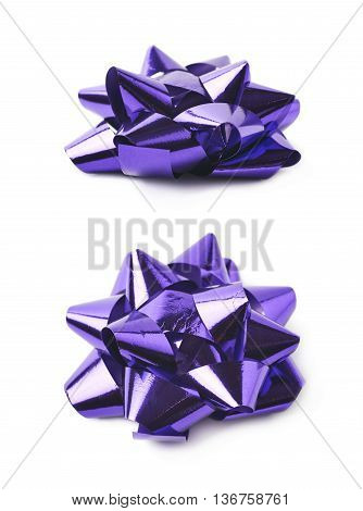 Decorational bow made of glossy violet tape, composition isolated over the white background, set of two different foreshortenings