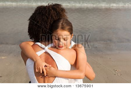 Portrait of a Daughter hugging her mother on the beach
