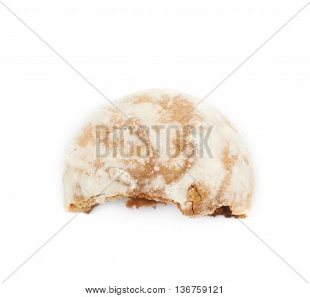 Single russian gingerbread cookie, bitten, composition isolated over the white background